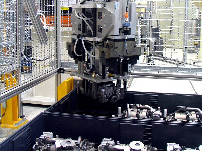 Robot-guided gripper equipped with an LTSOT500 scan sensor removes motor components from blisters